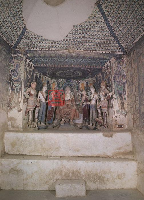 Constructed in the High Tang period, this cave has a truncated pyramidal ceiling. The ceiling center features a medallion pattern composed of flowers and clouds and draperies. The draperies extend to the four slopes covered with the thousand Buddha motifs (partly damaged). A niche with a flat ceiling in the west wall contains a seven figure group made in the Tang dynasty and repainted in the Qing dynasty. The ceiling is decorated with a parasol and lotuses. Each of the north and south sides out of the niche depicts a Bodhisattva. The south wall is covered with a western pure land illustration, the middle and lower parts of it was damaged. The north wall is also covered with an Amitayus sutra illustration with two side scenes respectively for the Sixteen Meditation and the story between Bimbisara and Ajatasattu. The lower part is lost. Most of the east wall has collapsed, ony a few images of the thousand Buddha motifs have survived on the north side of the entrance.