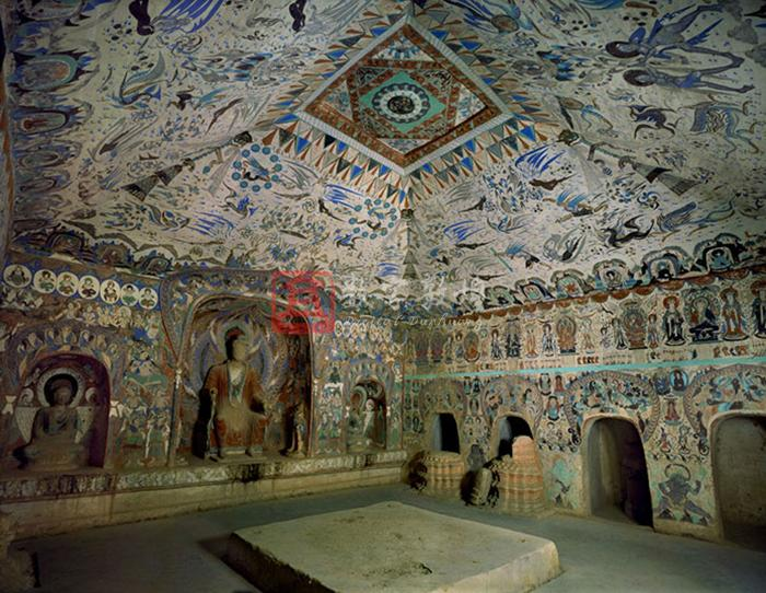 This cave was constructed during the Datong era in the Western Wei (according to the inscriptions on the north wall which has the dates of the fourth year and fifth year of the Datong era of the Western Wei, (538-548) and it is the dated earliest cave among the Dunhuang caves.The main chamber is square in plan and has a truncated pyramidal ceiling. A square altar was made in the center in the Yuan dynasty, and there are four symmetircal cells on each side walls. Inside or at the entrance of some cells are the remnants of the pagoda of the Yuan dynasty. The ceiling center highlights a parasol design, while the four slopes are covered with the images from Chinese mythology such as the traditional Chinese gods, and protectors of Buddhist laws, Mani Pearl, Guardian warriors, apsaras, god of Thunder, auspicious beasts, Fuxi and Nüwa, and etc. The bottom circle of the four slopes contains thirty-six monks in meditation in huts or in the mountain forests where all kinds of animals and hunting scenes are painted. There is a big niche in the west wall which has two small side cells. The west niche contains a seated Buddha with legs pendent and preaching. The side cells in the niche each have a meditation monk  with a cowl. The upper part of the space out of the niche is occupied with various images of all kinds of devas and heretic figures, such as the gods of the Sun and the Moon, the gods of the stars, Visnu, Mahesvara, Kumara, Vinayaka,  and worshipping bodhisattvas, below them are four heavenly kings and Vasistha. The brim of the niche at the bottom is decorated with the honeysuckle motifs. The North wall consists of the upper, middle and lower parts. The upper part is devoted to eleven musician apsaras holding different music instruments. The middle part is covered with the narrative story of five hundred robbers, which ends with the scene of Sakyamuni and Prabhutaratna sitting side by side. The lower part contains four cells. The spaces between the cells on the side walls depict karma stories about Bhadrika and his sister, the salvation of a bad ox, a young samanera committing suicide in order to obey Buddhist precepts, and a Brahman sacrificing his body so as to hear the preaching. These all are neither represented in a long strip with successive scenes or in a single picture. Below the story paintings are guardian warriors. The north wall consists of the upper and lower sections. The upper section are occupied by seven preaching scenes, each containing a votive text and donor figures at the bottom. The second and the seventh counting from the west each has an inscription in which the date can be identified. The lower section also contain four cells, just like those in the south wall. Three seated Buddha are painted on the space above the entrance in the east wall. On both the south and north sides of the entrance is a preaching scene in large size. The top layer of the ceiling of the corridor show traces of the bodhisattva in diamond position painted in the Middle Tang dynasty. The south wall has a illustration of Amoghapasa and the north has an illustration of Cintamani-cakra, both date to the Middle Tang period. The front chamber is a rectangle in plan, and the ceiling is a slope with traces of the Song dynasty murals. The west wall in the front chamber has a small cell above the entrance (numbered as cave 286). The south side of the entrance has some traces of the Song dyansty donor figures and below them the Middle Tang paintings can be seen. The north of the entrance with the picture of the Song dynasty male donor figures is numbered as cave 287 .