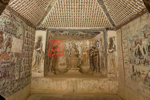 Located on the middle section of the Southern Area at Mogao, this cave was constructed in the High Tang and renovated in the Middle Tang, Song and Yuan dynasties. It is one of the representative cave of the Tang dynasty. The main chamber, square in plan, has a truncated pyramidal ceiling and a niche in the west wall. The ceiling center depicts a peony surrounded by cloud patterns.  On the four sides are various decorative patterns, such as the motif of two partly overlapped squares, half medallions, diamond lozenges,  medallions, and draperies in red, blue and green colors, looking bright and fresh. The four slopes are covered with the Thousand Buddha motifs. In the center of the south wall is a preaching scene (two pieces taken away by Langdon Warner in 1924). The central statue is lost, while the back halo in bas relief as well as one disciple and two bodhisattvas have survived. The ceiling of the niche highlights a preaching scene of Maitreya, in which two disciples, four bodhisattvas and two heavenly kings stand in order. There, heavenly kings wear  chain mail and tabards which can protect the legs in battles. There is no such example in other preaching scenes in Mogao. On the walls of the niche are eight disciples and two bodhisattvas in gorgeous costumes. An image of Avalokitesvara is painted on either side of the niche. The north wall is covered with the illustration of Amitayurbhavana-sutra with the pure land in the center and two side scenes illustrating the stories of the Sixteen meditations and of the stories Between King Bimbisāra and Ajātaatru, similar to the illustration of the Amitabha in composition. This illustration creates an elegant ambiance mainly in blue, green and black,  focuses on the incarnated boys on the lotuses in the pond, auspicious birds and beasts, as well as musicians. It represents a style of the same themes of the High Tang dynasty.